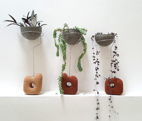 Succulents, paperpulp vessels, sea sculpted brick from coastal erosion