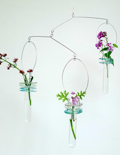Three suspended single stem vases